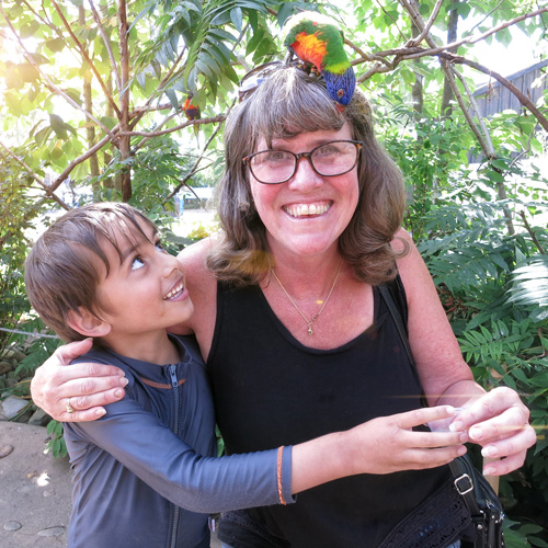Photo from Louisville KY zoo, of grandson Sam, and Grandmother Artful Barb, who has a bird on top of her head