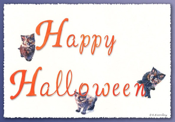 """Happy Halloween"" message hand-lettered, with three cats among the letters."